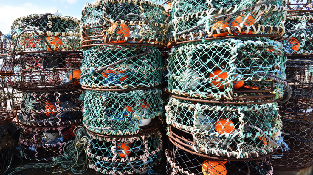 Fish trap stacked up along the harbour at Apollo Bay, Victoria, Australia